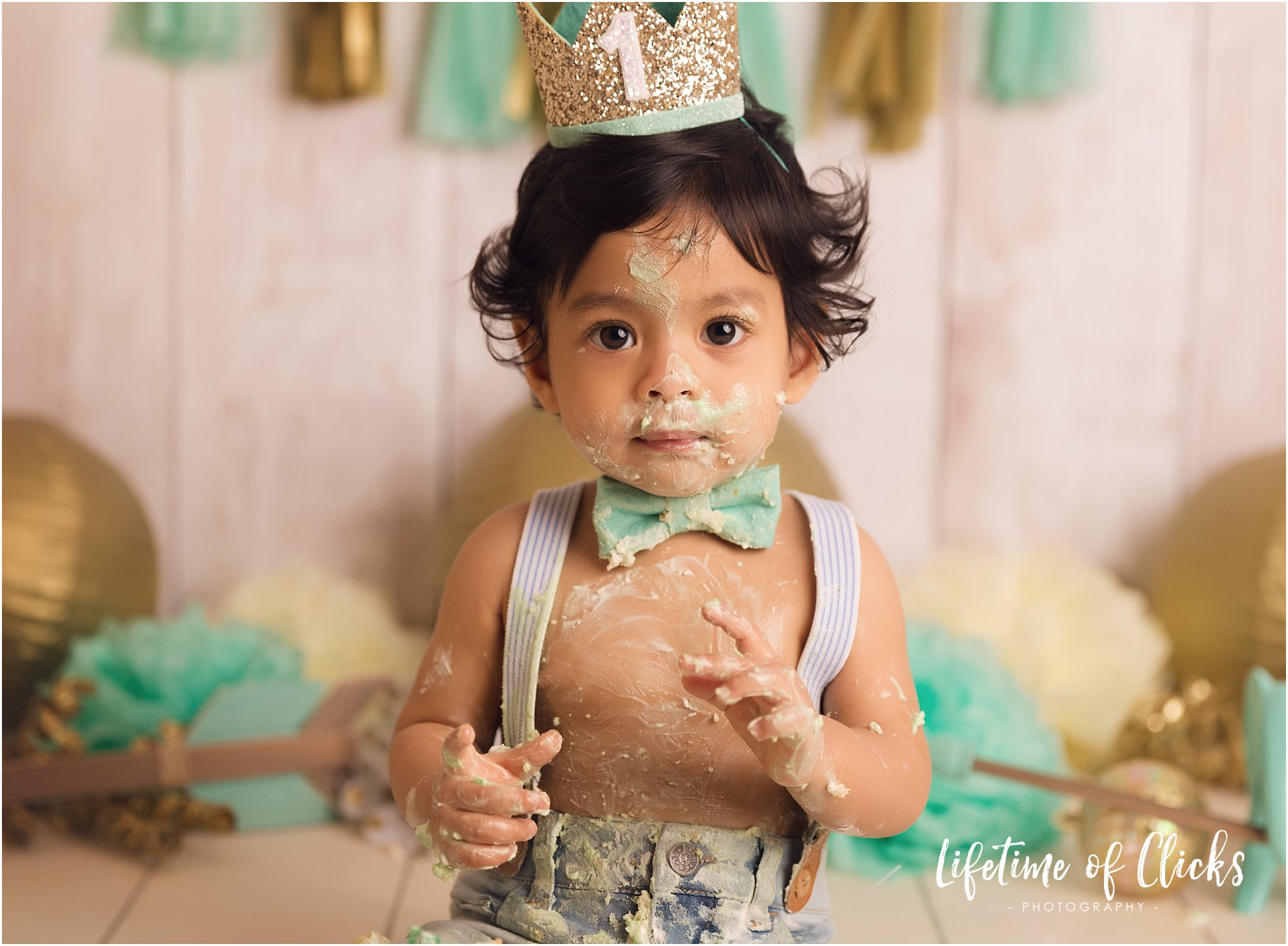 One year old boy at his cake smash session