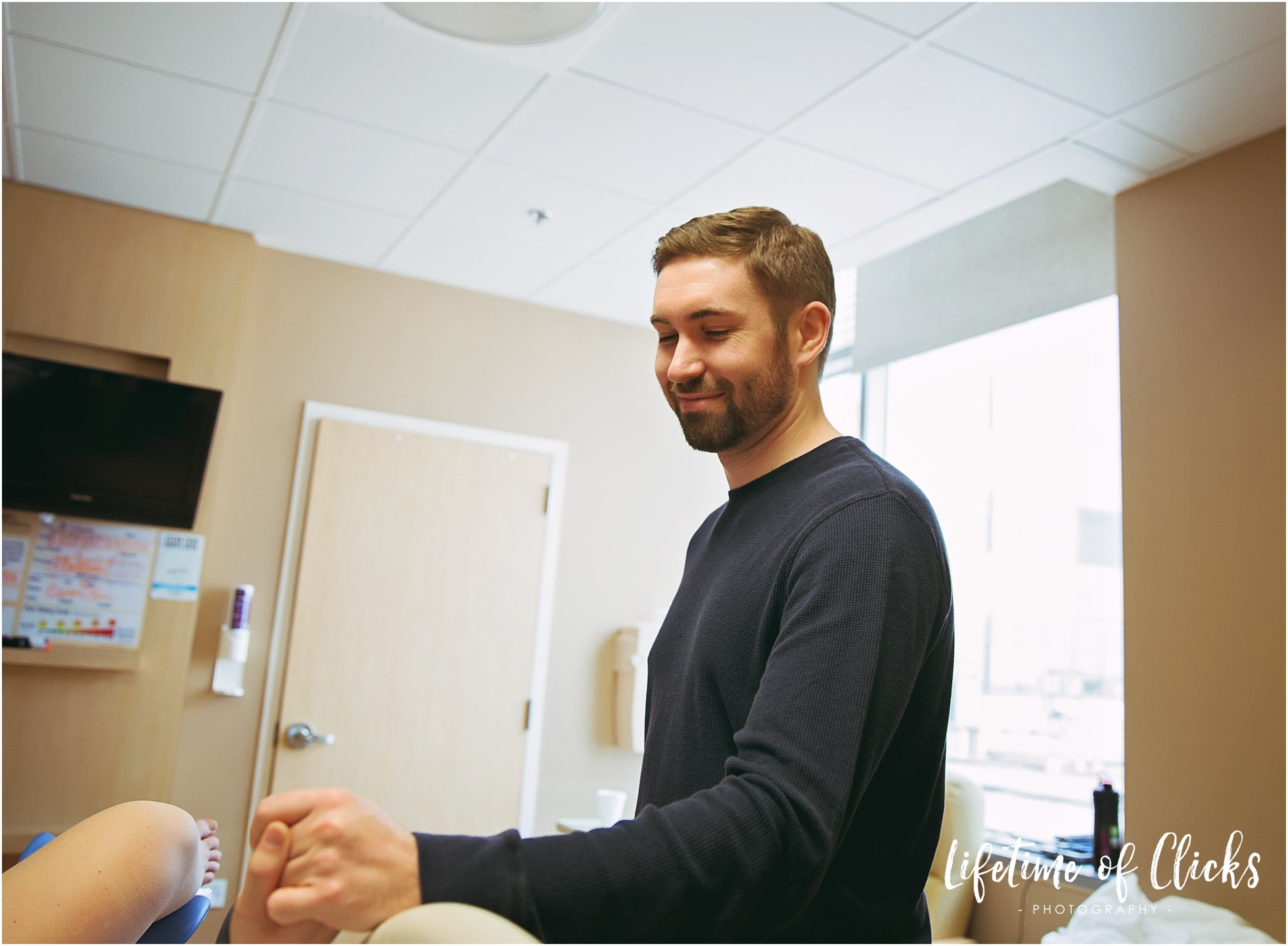 Caring father being supportive of his wife during delivery