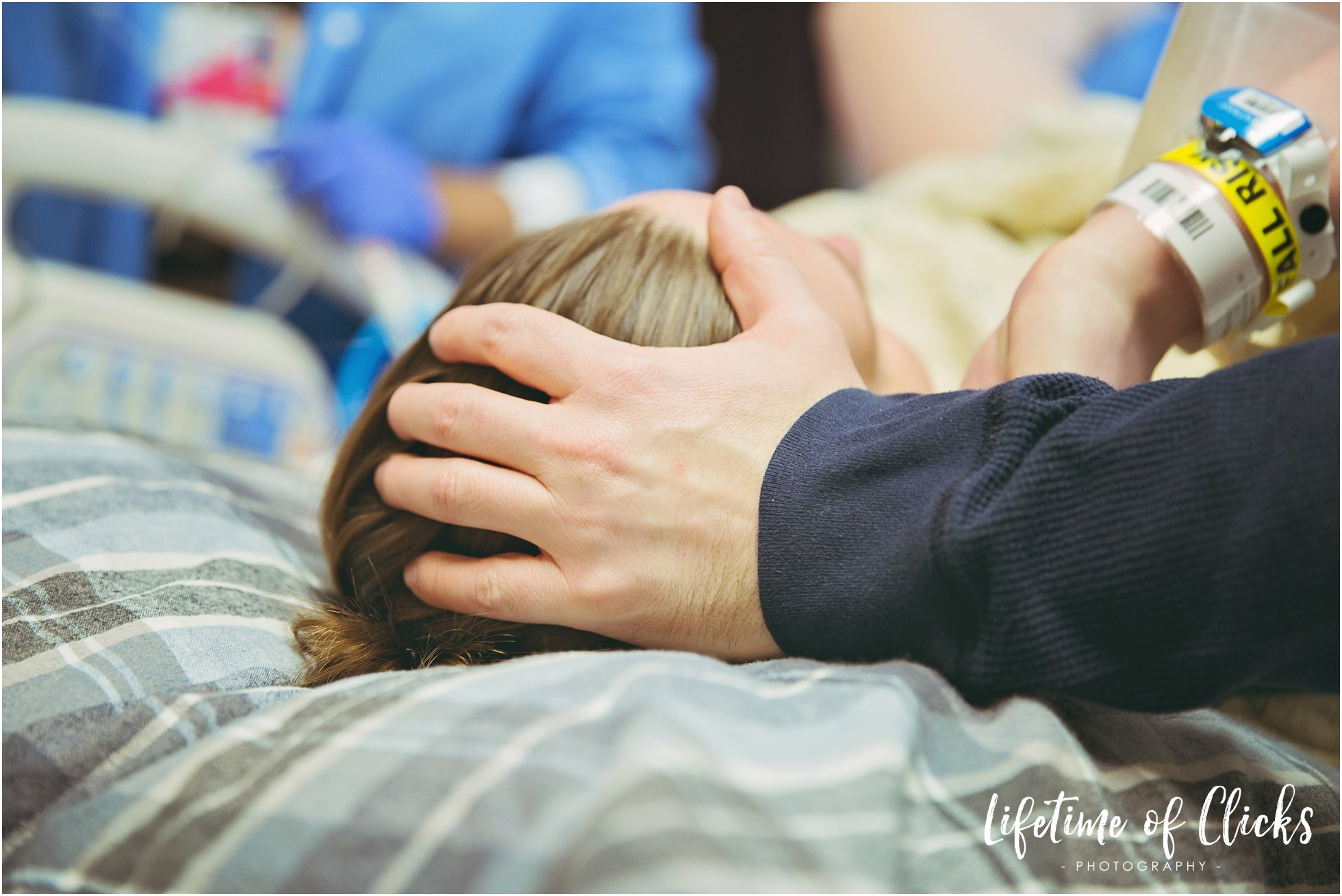 Tender moment between husband and wife during birth photography session