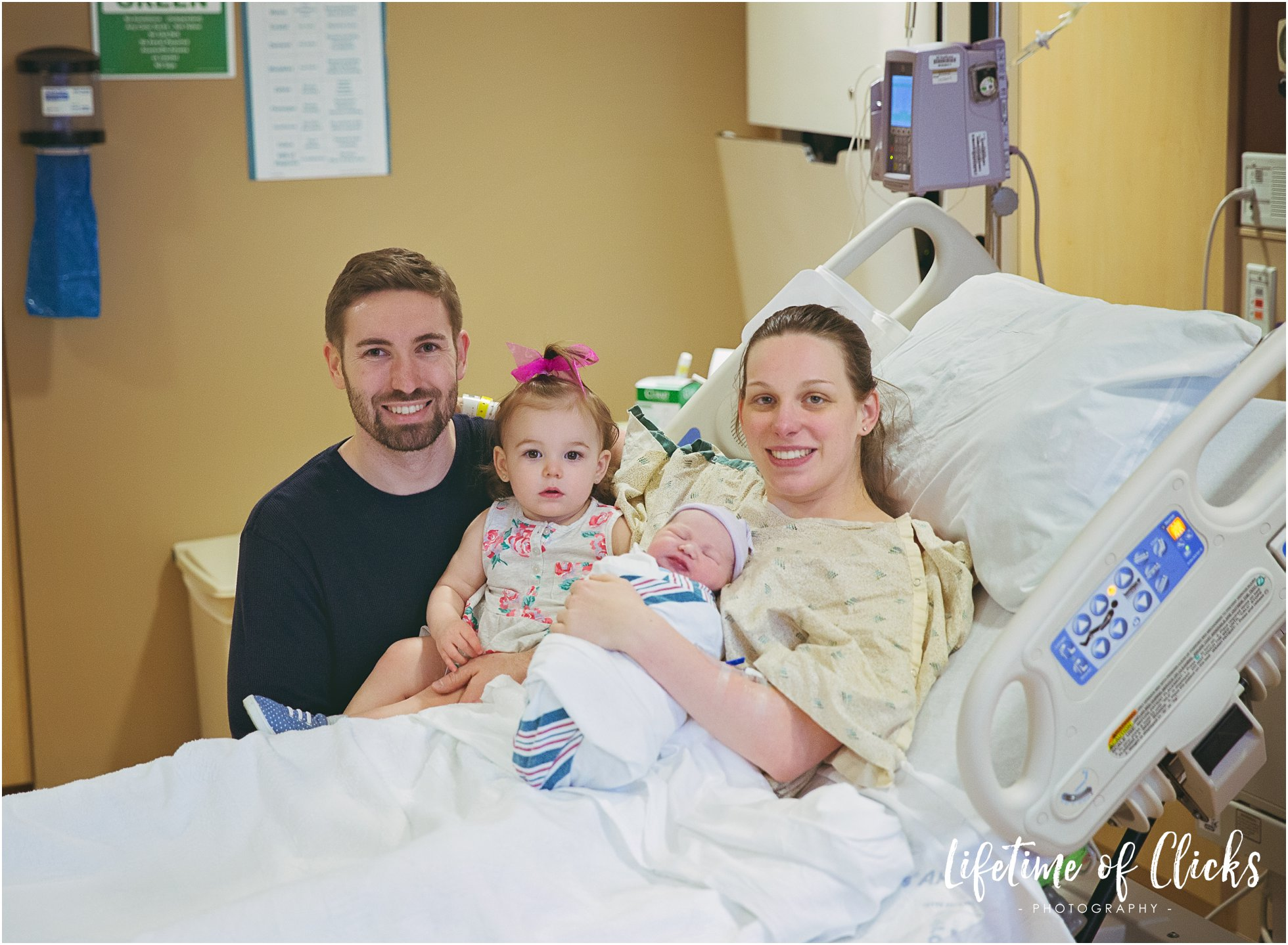 Family portrait after birth of newborn baby