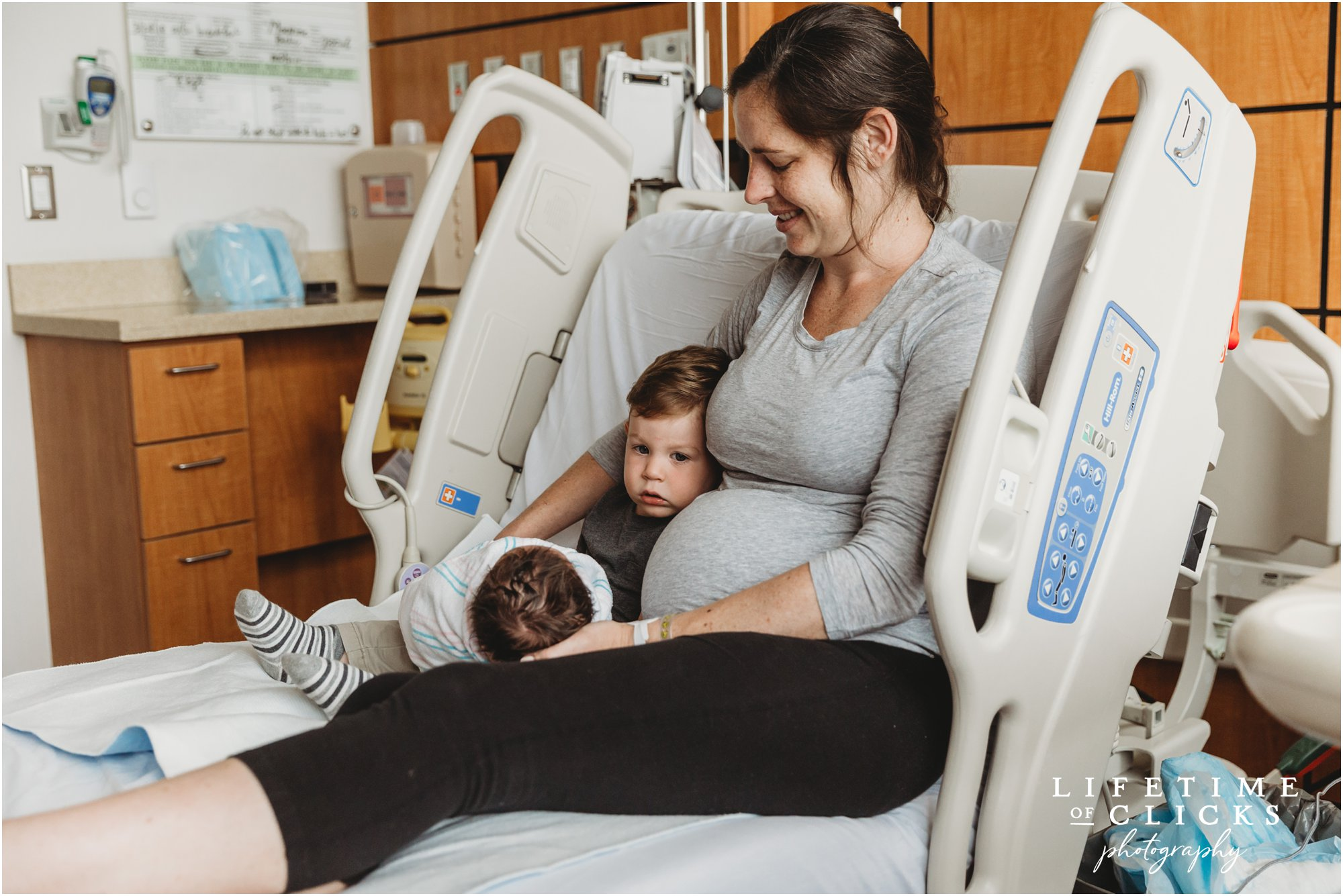 image of mother with her two sons in the hospital