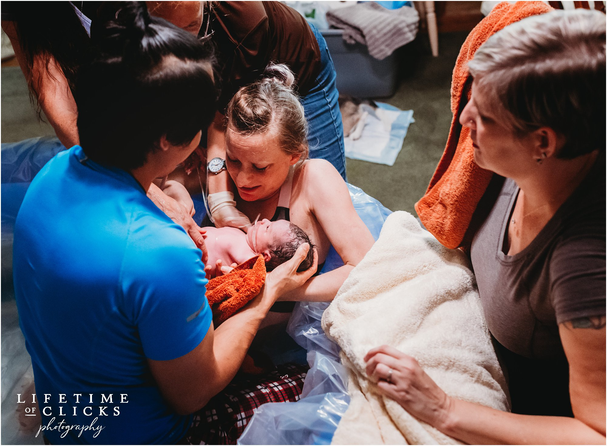 new mother seeing her baby after water birth