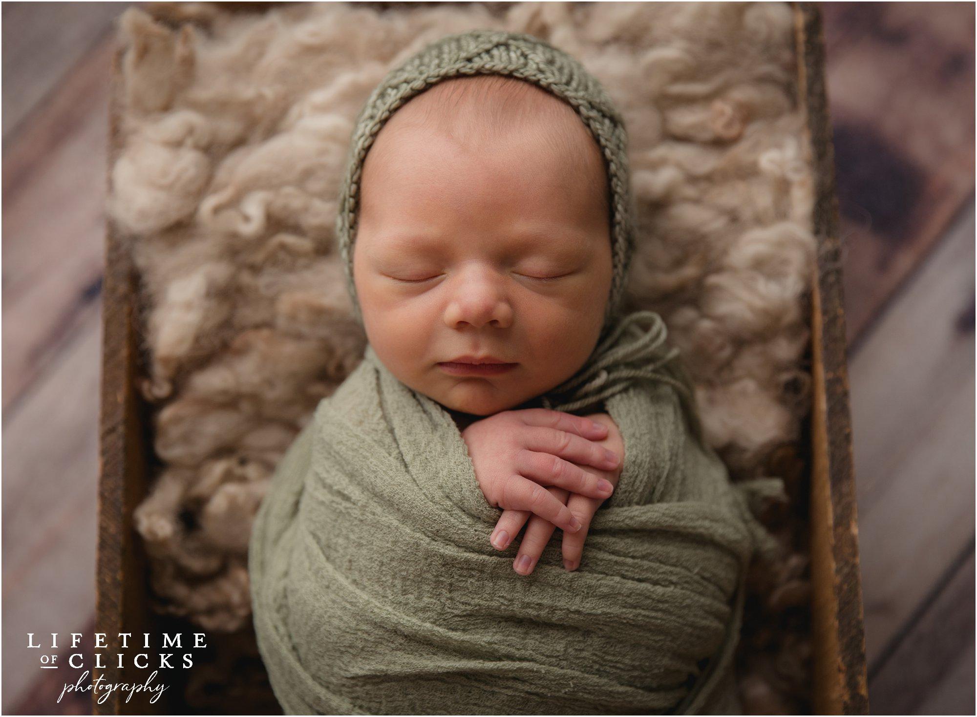 newborn session with green wrap
